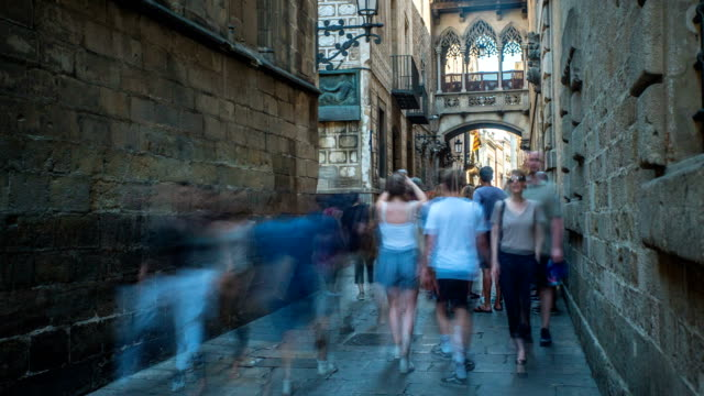 timelapse of street in th gothic quarter in barcelona - gothic quarter barcelona stock videos and b-roll footage