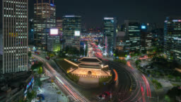 Timelapse of Sungnyemun gate (Namdaemun Market) or Namdaemun gate with light trails of car at night in Seoul, South korea.