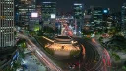 Timelapse of Sungnyemun gate (Namdaemun Market) or Namdaemun gate with light trails of car at night in Seoul, South korea.