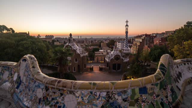 barcelona: timelapse of sunrise at parc guell in barcelona - barcelona stock-videos und b-roll-filmmaterial