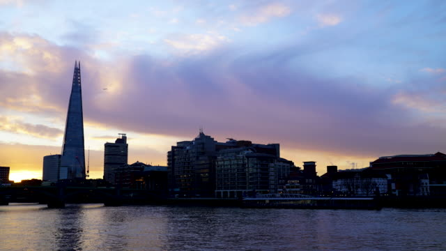Time-lapse of sunrise breaking over the River Thames with a view of London Bridge and the Shard
