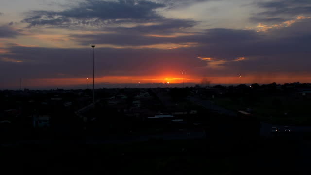 time-lapse of sunrise in township/ south africa - electric lamp stock videos & royalty-free footage