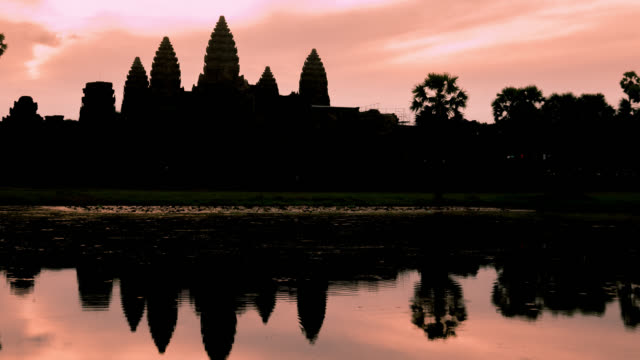 timelapse of sunrise on angkor wat temple - angkor stock videos and b-roll footage