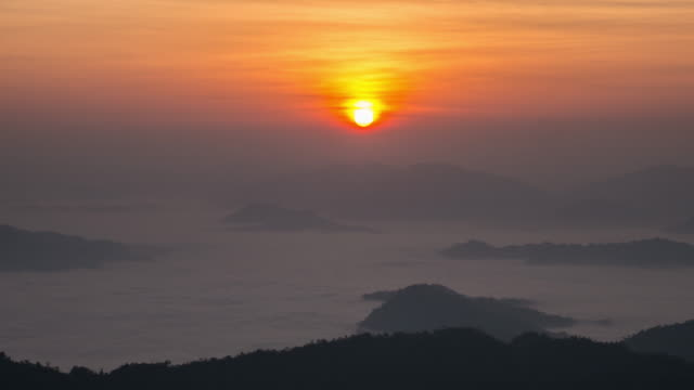 Time-lapse of sunrise on the mountain with movement mist , Nature footage background