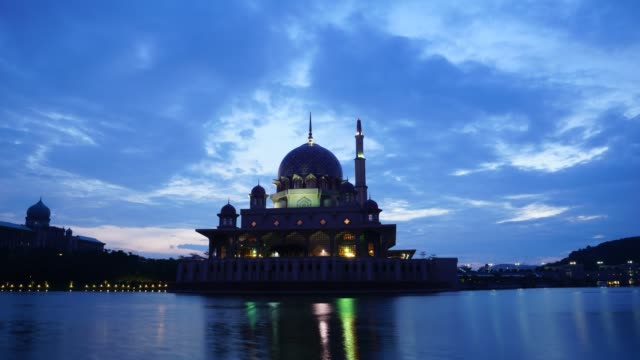 timelapse of sunrise over putra mosque in putrajaya, malaysia - putrajaya stock videos & royalty-free footage