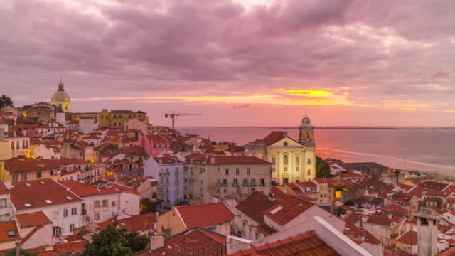 Timelapse of sunrise over the Alfama - Lisbon old town. Portugal. April, 2017