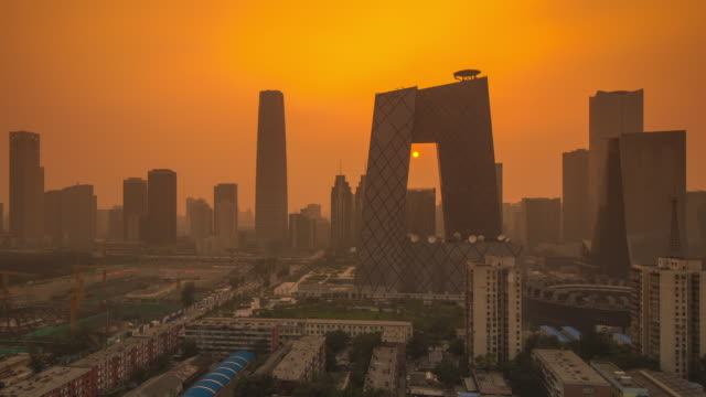 Timelapse of Sunset in Beijing, China Through CCTV Building with Wide View of City