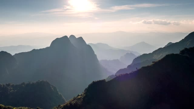 time-lapse of sunset on mountain peak at national park. doi luang chiang dao wildlife sanctuary - north stock videos and b-roll footage