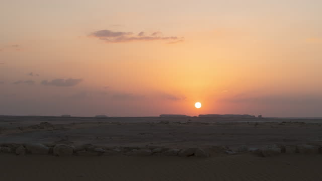 timelapse of sunset over a desert in egypt - egypt stock videos & royalty-free footage