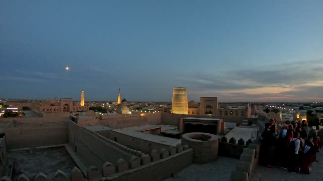 timelapse of sunset over ancient city of khiva, uzbekistan - madressa stock videos and b-roll footage