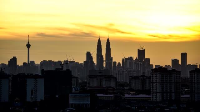 timelapse of sunset over downtown kuala lumpur in malaysia - menara kuala lumpur tower stock videos & royalty-free footage