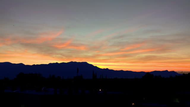 Time-lapse of sunset over mountain range