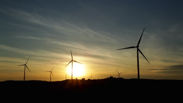timelapse of sunset windmills - silvestre stock videos & royalty-free footage