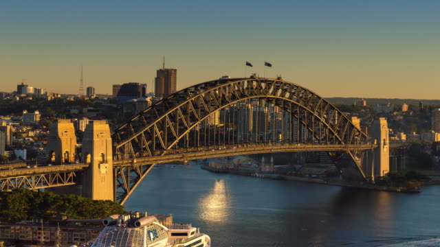 timelapse of sydney harbour bridge with moody sky - moody sky stock videos & royalty-free footage