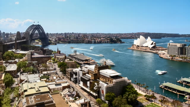 timelapse of sydney harbour, with the harbour bridge and opera house from an elevated point of view - international landmark stock videos & royalty-free footage