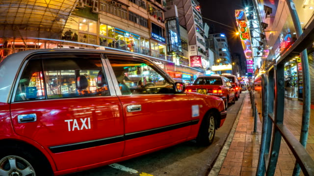 timelapse of taxi cabs queue in mong kok shopping area in hong kong - mack2happy stock videos and b-roll footage