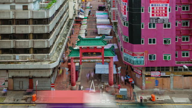 time-lapse of temple street night market in hong kong - temple street market stock videos and b-roll footage