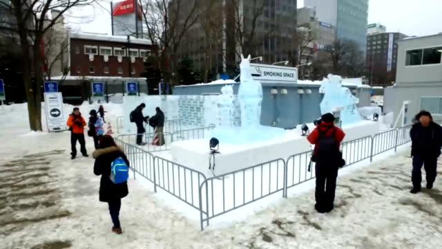 timelapse of the 68th sapporo snow festival on february 6 2017 in sapporo hokkaido japan - schneefestival stock-videos und b-roll-filmmaterial