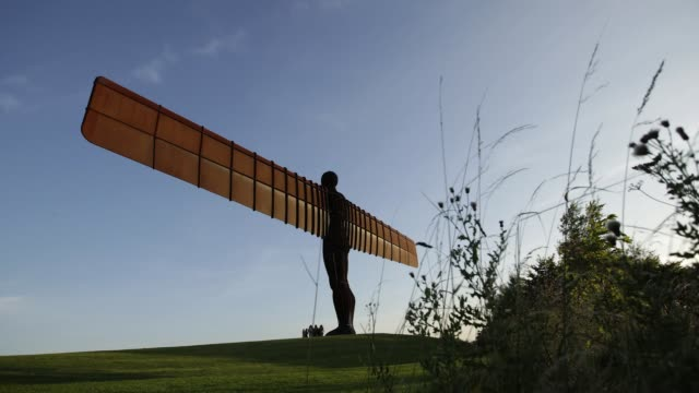 timelapse of the angel of the north sculpture designed by sir antony gormley near gateshead united kingdom on wednesday august 17 2016 - angel of the north stock videos and b-roll footage