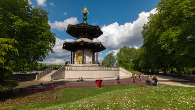 london: timelapse of the buddhism temple, peace pagoda, in battersea park - battersea stock videos & royalty-free footage