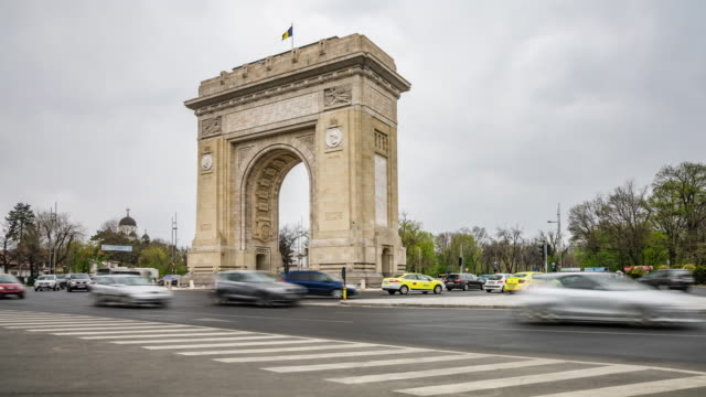 timelapse of the busy roundabout of arch of triumph in bucharest, romania in supreme quality (4k/uhd to hd) - stock video - independence stock videos & royalty-free footage