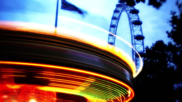 Timelapse of the Carousel on the Southbank in London with the London Eye wheel in the background