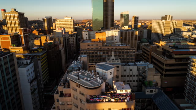 Timelapse of the city centre of Johannesburg showing the High Court of South Africa, old Sun International and Carlton Tower at sunset