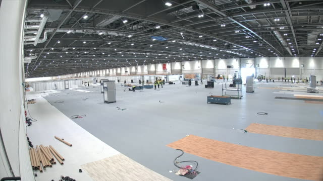 timelapse of the construction of the interior of nhs nightingale hospital at the excel centre, a field hospital to help during coronavirus crisis - temporary stock videos & royalty-free footage