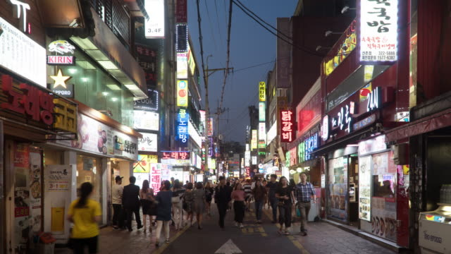 timelapse of the customers walking in the shopping street, seoul, south korea - population explosion stock videos and b-roll footage