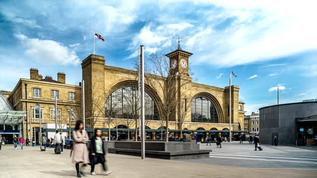 stockvideo's en b-roll-footage met time-lapse of the exterior of kings cross railway station, london - station london king's cross
