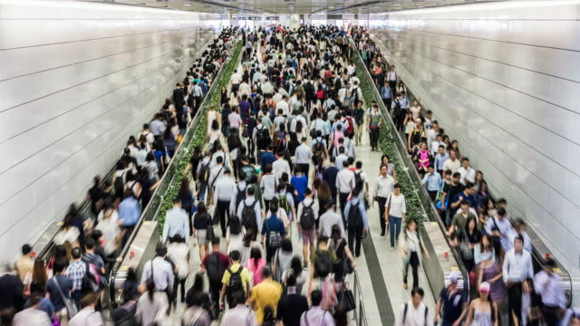 timelapse of the hong kong subway during rush hour - beengt stock-videos und b-roll-filmmaterial