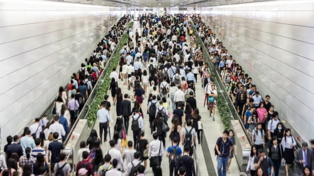 timelapse of the hong kong subway during rush hour - hauptverkehrszeit stock-videos und b-roll-filmmaterial
