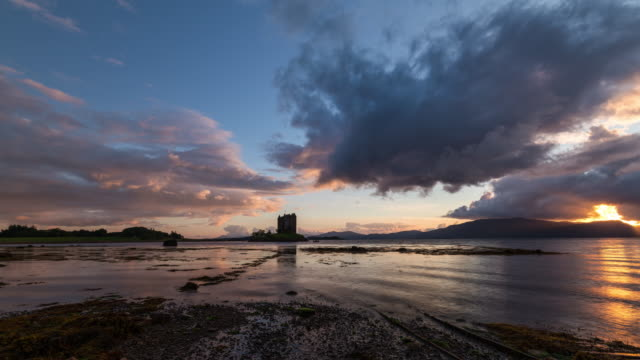 Timelapse of the iconic Castle Stalker during sunset and low tide