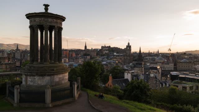 timelapse of the iconic edinburgh skyline during dusk - edinburgh castle stock videos & royalty-free footage