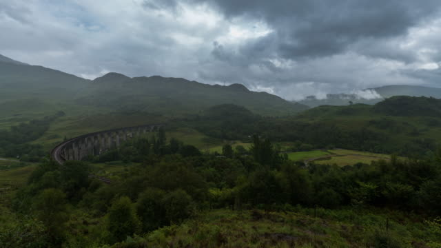 timelapse of the iconic glenfinnan viaduct in scotland - locomotive stock videos & royalty-free footage