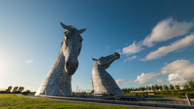 Timelapse of the Iconic Kelpies sculpture in a sunny day near Edinburgh, Scotland