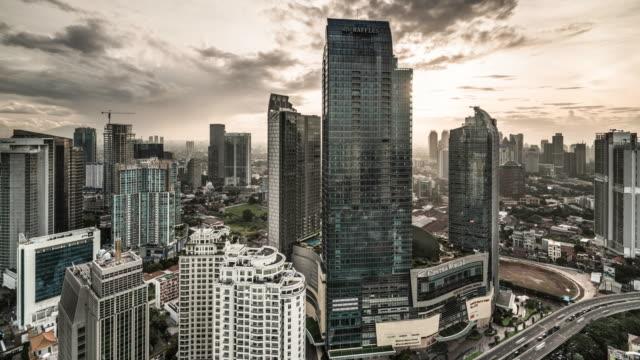 vidéos et rushes de timelapse of the jakarta skyline - gris