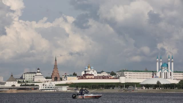 Timelapse of the Kazanka river flowing past the Kazan Kremlin complex and city skyline in Kazan Russia on Tuesday July 21 2015