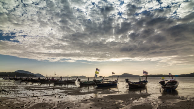 Timelapse of the long-tails on the Rawai beach in low water during high tide, Thailand. January, 2016.