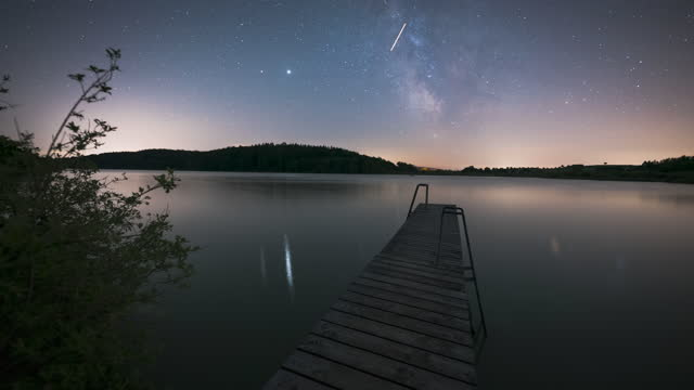 timelapse of the milky way over a lake with pier - germany stock videos & royalty-free footage