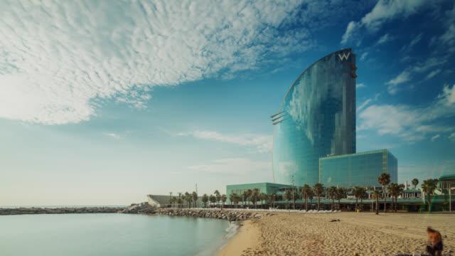 Timelapse of the modern hotel on the beach in Barcelona, Spain.