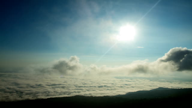 Timelapse of the morning sun and clouds with fog