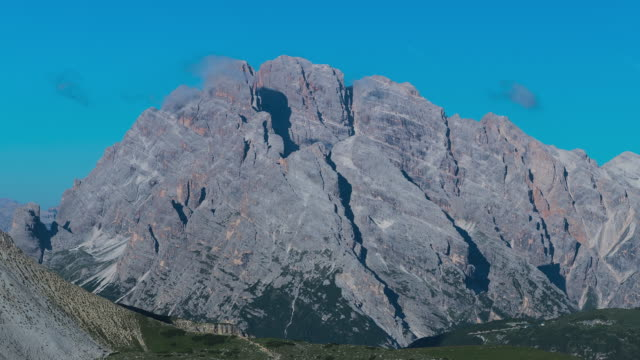 T/L Timelapse of the mountain range Monte Piana in the Dolomites, Italy