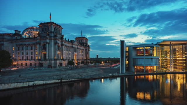 time-lapse of the reichstag building and river spree at dusk - lobe stock videos & royalty-free footage