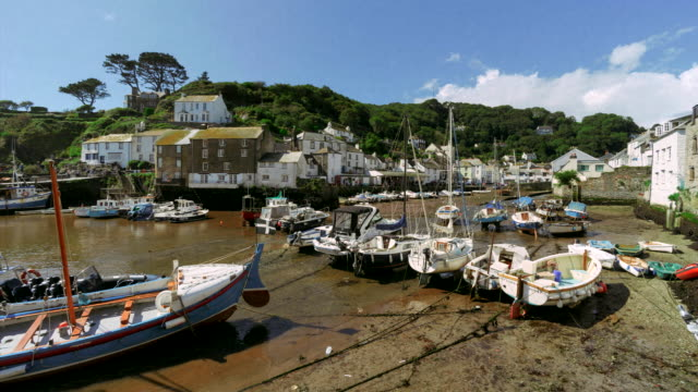 time-lapse of the rising tide at polperro harbour, cornwall, uk - cornwall england stock videos & royalty-free footage
