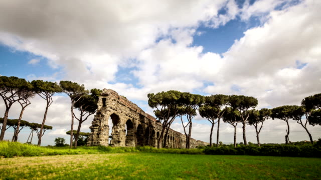 timelapse of the roman aqueduct at parco degli acquedotti - aqueduct stock videos and b-roll footage