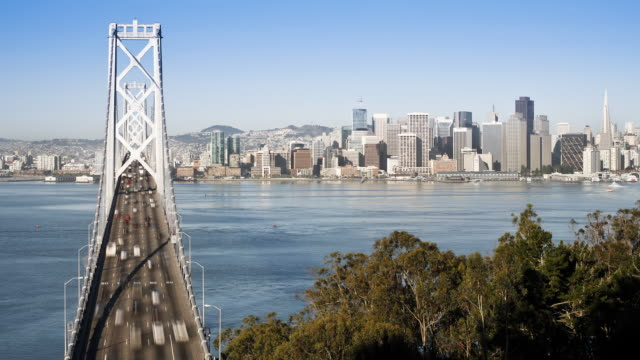 time-lapse of the san francisco bay bridge and city skyline viewed from treasure island, san francisco, california, united states of america - cantilever stock videos & royalty-free footage
