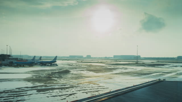 timelapse of the schiphol airport in amsterdam during a winter day - air traffic control tower stock videos and b-roll footage