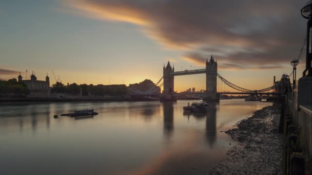 time-lapse of the sun rising behind tower bridge, london, uk - tower of london stock videos & royalty-free footage