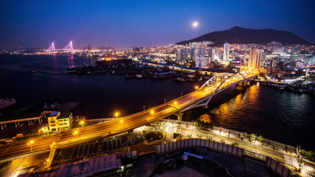 timelapse of the traffic and skyline of the busan, southkorea - busan stock videos & royalty-free footage